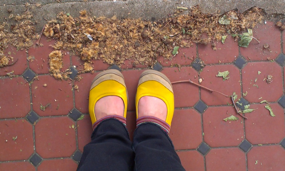 Feet in yellow shoes tiled floor