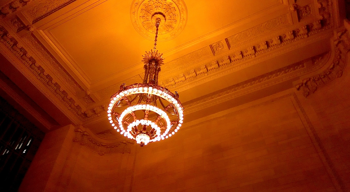 A chandelier with rows of lights