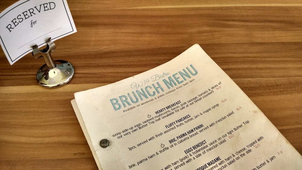 brunch menu on wooden table