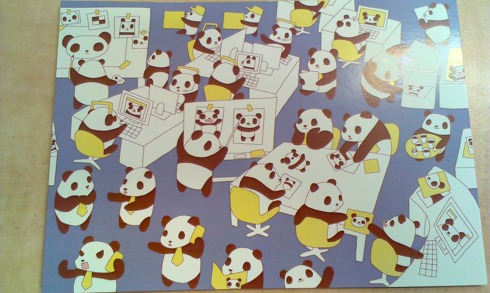 Drawing of pandas in an office