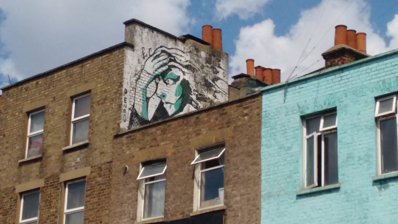 Graffiti art of face on side of building