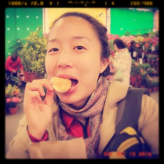 Asian woman eating Taiwanese pancake